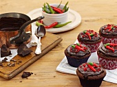 Chilli and chocolate cupcakes topped with plain chocolate and fresh chilli peppers