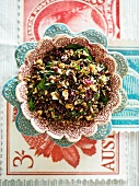 A salad of wild rice, sour cherries, baby spinach and roasted hazelnuts