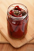 Pickled chillies in a screw-top jar