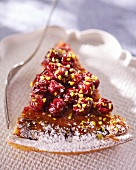 A slice of sour cherry tart with pistachios