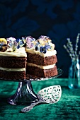 Chocolate and lavender layer cake with candied violets