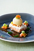Trout fillet with meringue crust and salmon ice cream