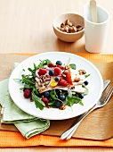 Salad with cold roast pork and berries