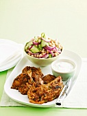 Lamb tikka masala with cucumber and chickpea salad and yoghurt sauce