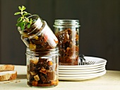A trio of goulash in preserving jars