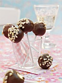 Cake pops with chocolate glaze and chopped nuts