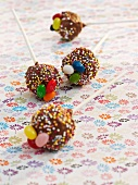 Cake pops decorated with sugar eggs for Easter