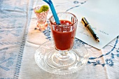 A tomato drink with peppers and blood oranges