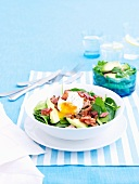 A salad of spinach, bacon and poached egg