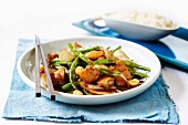 Chicken with green beans and macadamia nuts