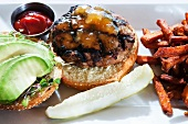 Grilled Turkey Burger with Mango Chutney, Avocado and Sprouts; French Fries