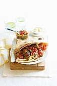 Lebanese flatbread filled with minced meat and tomato salsa