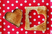 A heart cut out of a slice of toast