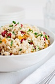 Cous cous salad with pomegranate seeds, clementine, chopped mint and flat leaf parsley