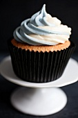 Earl Grey tea infused cupcakes topped with two tone Earl Grey scented buttercream