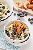 Blueberry and couscous salad with grilled peach wedges