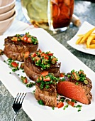 Beef medallions with diced peppers and chives