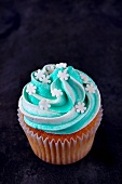 A cupcake topped with mint buttercream icing