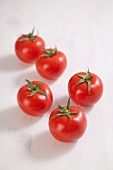Five fresh tomatoes