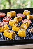 Corn on the Cob on the Grill; Halved Tomatoes