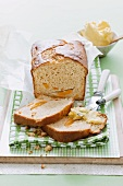 Peach and passion fruit bread, one slice spread with butter