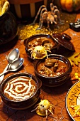 Three Halloween soups with fun Halloween decorations