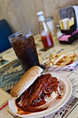 Barbecued Pulled Pork Sandwich with Fries and a Coke