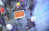 A worker holding a crate of smoked salmon in the factory