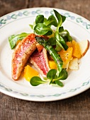 Red mullet with lamb's lettuce, asparagus and orange and apple pieces