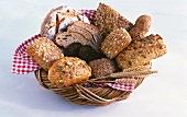 Wholemeal bread and rolls in a bread basket