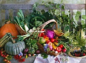 A basket of fruit and vegetables on a wooden bench