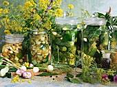 Four jars of pickled gherkins
