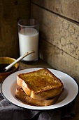 French toast with maple syrup and a glass of milk