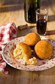 Arancini de paella (deep-fried rice balls with seafood, Spain)
