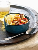 Noodles and Beef Goulash in a Bowl; Spoon and a Glass of Beer