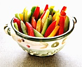 Red, Green and Yellow Bell Pepper Slices in a Decorative Bowl