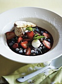 Red wine and peach soup with berries
