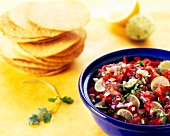 Bowl of Fresh Pico de Gallo with Stacked Corn Tortillas