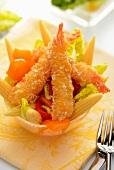 Vegetable salad with tempura prawns