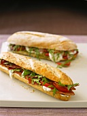 Baguette sandwiches filled with tomato, mozzarella and rocket