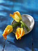 Courgette flowers in a metal dish