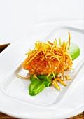 Char tartare with crispy potato straw on lettuce purée