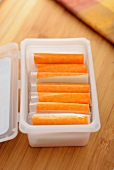 Surimi sticks in a plastic container