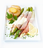 Asparagus wrapped in ham with Hollandaise sauce and potatoes