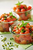 Watermelon and Date salad with roasted pistachios, selective focus