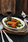 Breaded cod with shredded savoy cabbage