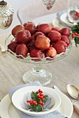 Red apples as a table decoration on a Christmassy dining table