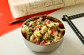 Pasta salad with cheese and salami