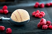 Raspberry ice cream and frozen raspberries