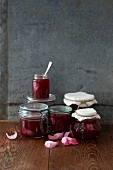 Several preserving jars of rose jam